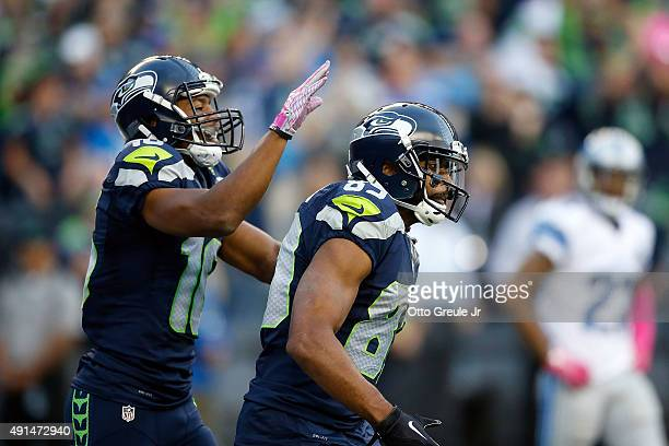 Doug Baldwin of the Seattle Seahawks celebrates with Tyler Lockett of the Seattle Seahawks after scoring a touchdown during the second quarter of a...