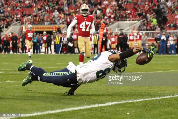 Doug Baldwin of the Seattle Seahawks dives into the end zone for a touchdown against the San Francisco 49ers during their NFL game at Levi's Stadium...