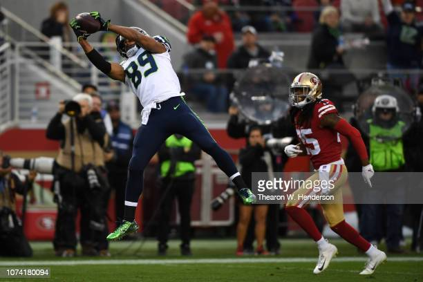 Doug Baldwin of the Seattle Seahawks makes a catch and runs for a touchdown against the San Francisco 49ers during their NFL game at Levi's Stadium...