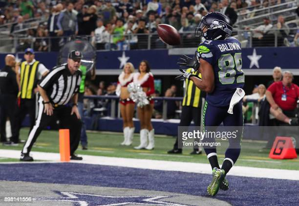 Doug Baldwin of the Seattle Seahawks makes a touchdown reception in the fourth quarter against the Dallas Cowboys at ATT Stadium on December 24 2017...