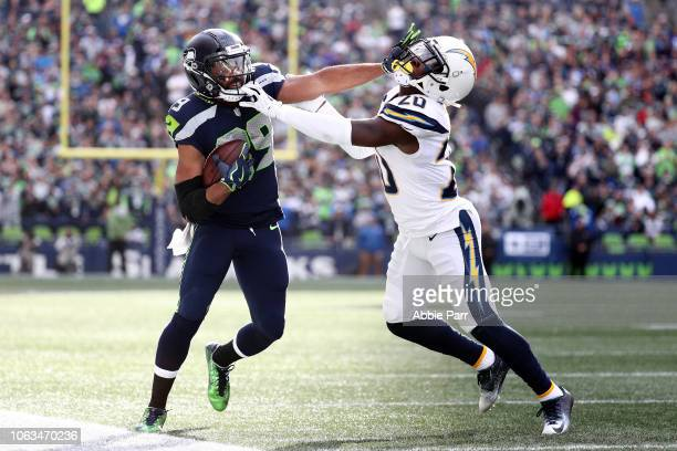 Doug Baldwin of the Seattle Seahawks runs with the ball while being tackled by Desmond King II of the Los Angeles Chargers in the second quarter at...