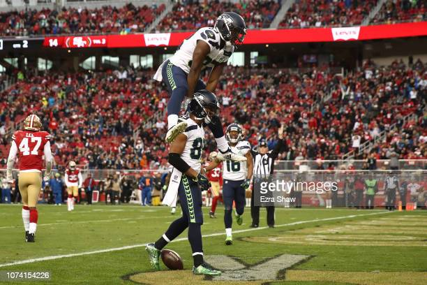 Doug Baldwin of the Seattle Seahawks vaulted by David Moore after scoring a touchdown against the San Francisco 49ers during their NFL game at Levi's...