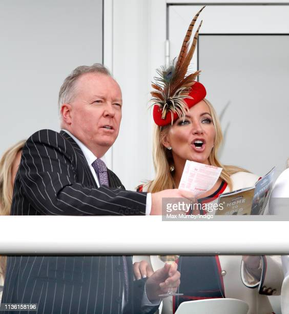 Doug Barrowman and Baroness Michelle Mone watch the racing as they attend day 4 'Gold Cup Day' of the Cheltenham Festival at Cheltenham Racecourse on...