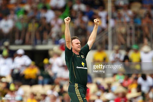 Doug Bollinger of Australia celebrates taking the wicket of Kieron Pollard of the West Indies during the second One Day International between...