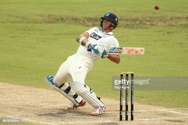Doug Bollinger of New South Wales avoids a short pitched delivery by Cameron Green of Western Australia during the Sheffield Shield match between...