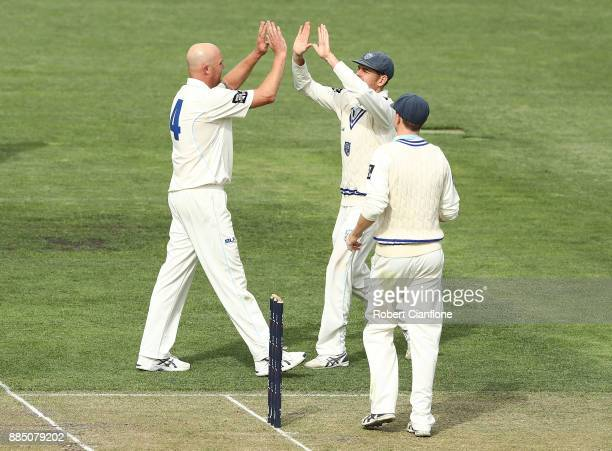 Doug Bollinger of NSW celebrates after taking the wicket of George Bailey of Tasmania during day two of the Sheffield Shield match between New South...