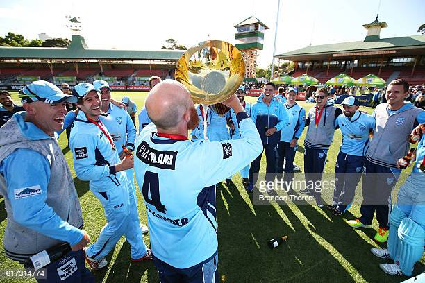 Doug Bollinger of the Blues drinks from the Matador BBQs One Day Cup after victory in the Matador BBQs One Day Cup Final match between Queensland and...