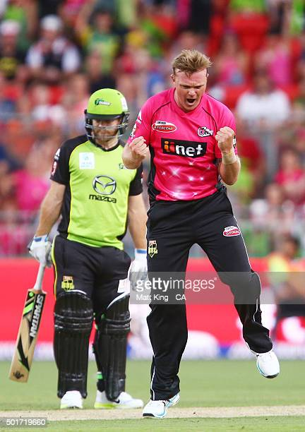 Doug Bollinger of the Sixers celebrates taking the wicket of Aiden Blizzard of the Thunder during the Big Bash League match between the Sydney...