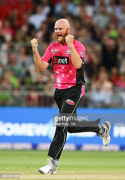 Doug Bollinger of the Sixers celebrates taking the wicket of Chris Green of the Thunder during the Big Bash League match between the Sydney Thunder...