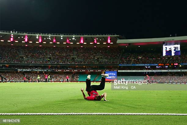 Doug Bollinger of the Sixers takes a catch to dismiss Michael Hussey of the Thunder during the Big Bash League match between the Sydney Sixers and...
