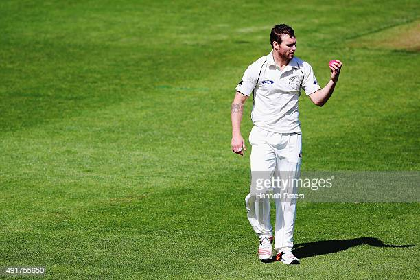 Doug Bracewell looks at the new pink cricket ball during a New Zealand cricket training session at Seddon Park on October 8 2015 in Hamilton New...