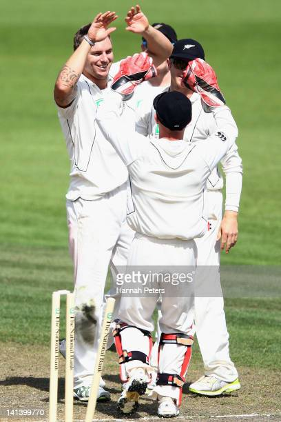 Doug Bracewell of New Zealand celebrates after bowling Vernon Philander of South Africa out during day two of the Second Test match between New...