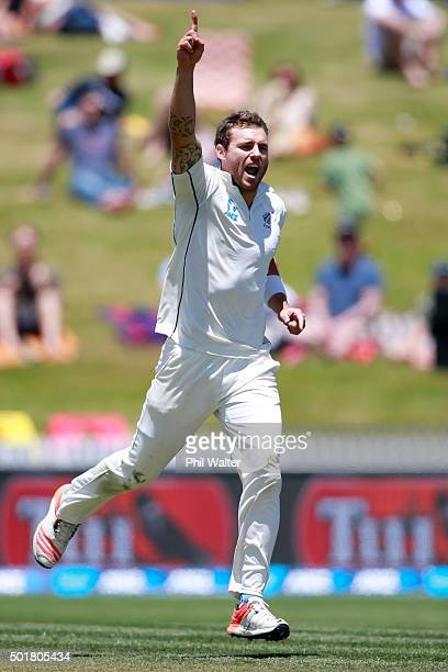 Doug Bracewell of New Zealand celebrates his wicket of Dinesh Chandimal of Sri Lanka during day one of the Second Test match between New Zealand and...