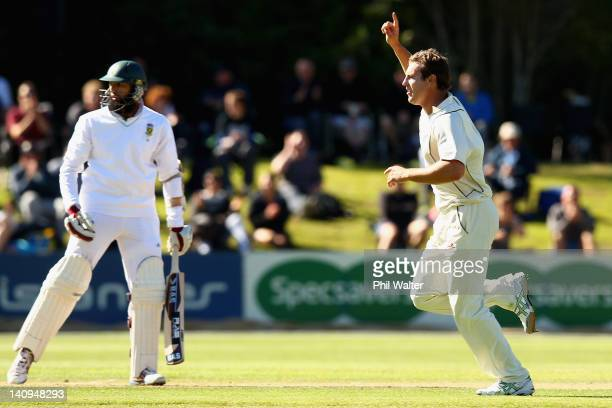 Doug Bracewell of New Zealand celebrates his wicket of Hashim Amla of South Africa during day three of the First Test match between New Zealand and...