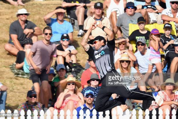 Doug Bracewell of New Zealand fields the ball during game one of the Twenty20 series between New Zealand and the West Indies at Saxton Field on...