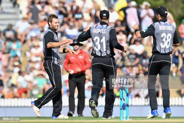 Doug Bracewell of New Zealand is congratulated by team mates after dismissing Shai Hope of the West Indies during game one of the Twenty20 series...