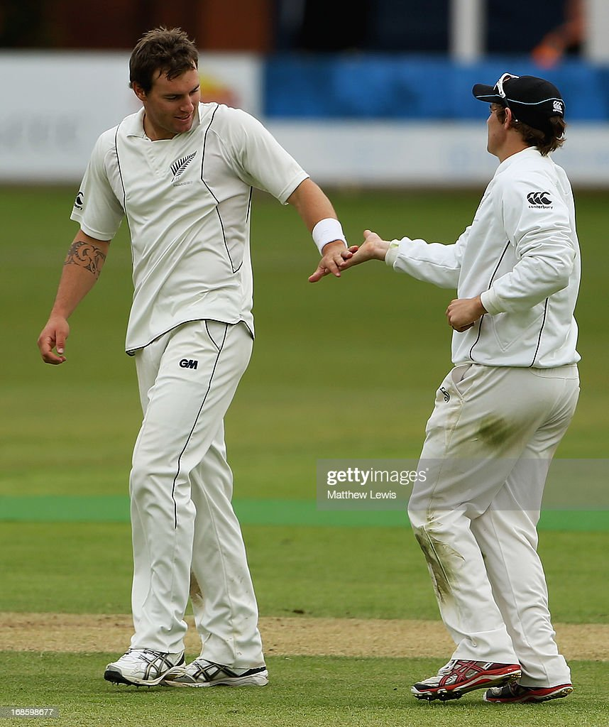 Doug Bracewell (L) of New Zealand is congratulated on bowling Chris Woakes of England Lions during day four of the tour match between England Lions and New Zealand at Grace Road on May 12, 2013 in Leicester, England.