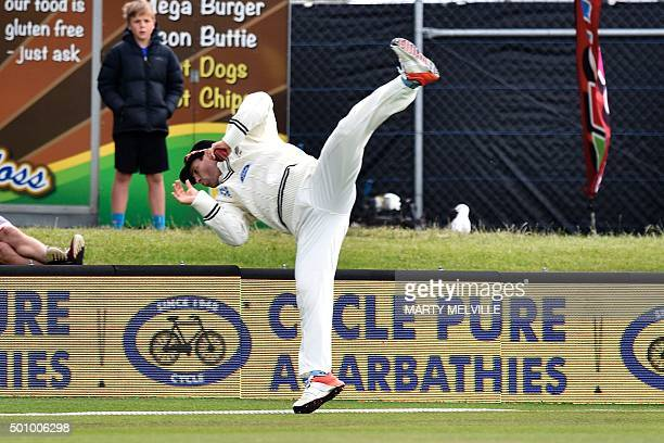 Doug Bracewell of New Zealand jumps to take a catch from Milinda Siriwardana of Sri Lanka but falls over the boundary rope when he lands during day...
