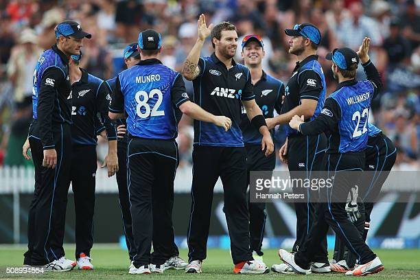 Doug Bracewell of the Black Caps celebrates the wicket of Usman Khawaja of Australia during the 3rd One Day International cricket match between the...