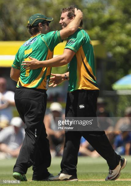 Doug Bracewell of the Stags is congratulated by Jamie How on his wicket of Lou Vincent of the Aces during the final of the HRV Cup Twenty20 match...