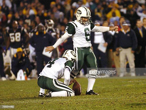 Doug Brien of the New York Jets follows through on the game winning field goal against the San Diego Chargers overtime of the AFC Wild Card Playoffs...