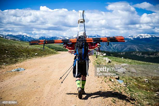Doug Briggs of Breckenridge carries the ski gates that will be used to setup the course for the 49th running of the Epworth Cup an unofficial ski...