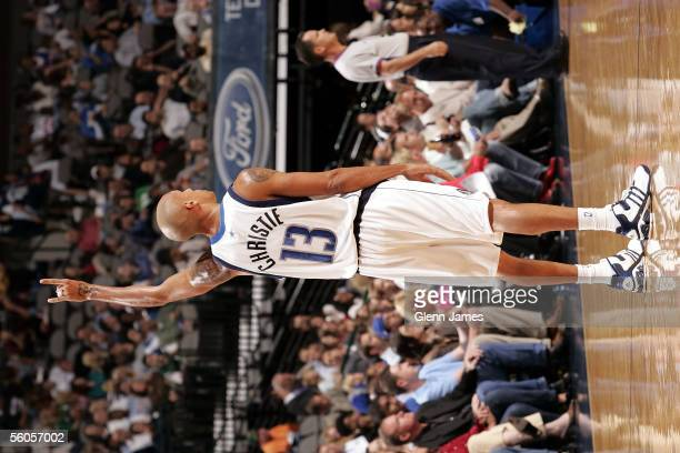 Doug Chrisite of the Dallas Mavericks signals gestures to his wife during the preseason game against the New York Knicks at American Airlines Arena...