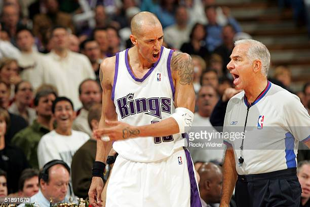 Doug Christie of the Sacramento Kings argues with official Bennett Salvatore during a game against the Miami Heat on December 23 at Arco Arena in...