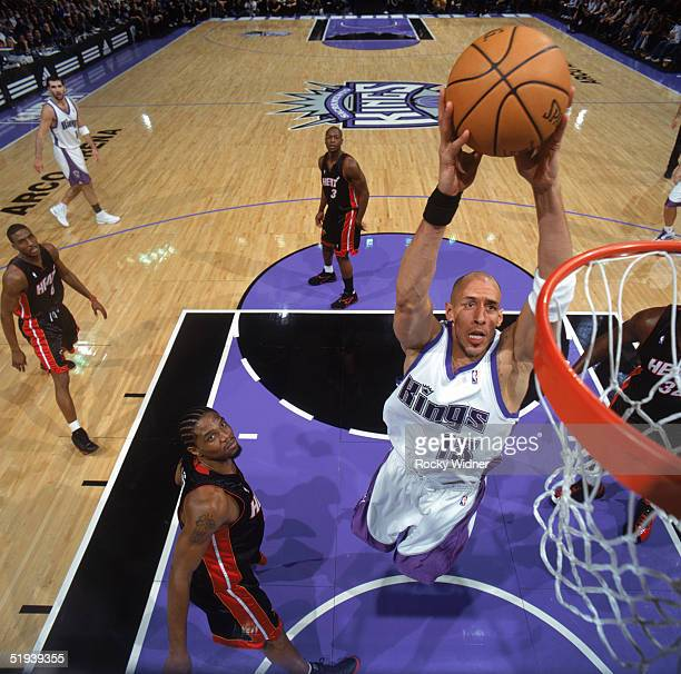 Doug Christie of the Sacramento Kings drives to the basket during a game against the Miami Heat at Arco Arena on December 23 2004 in Sacramento...