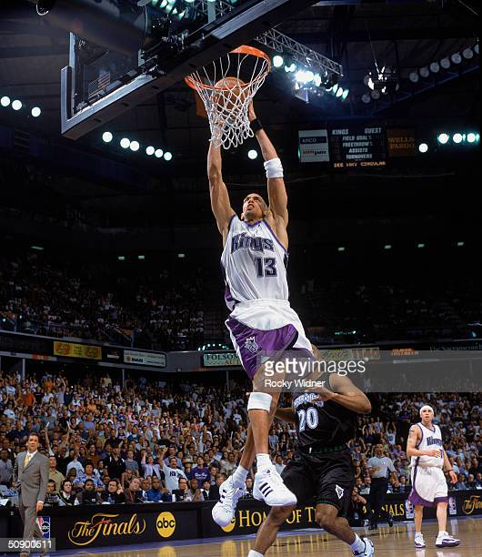 Doug Christie of the Sacramento Kings goes to the hoop against the Minnesota Timberwolves in Game Six of the Western Conference Semifinals during the...