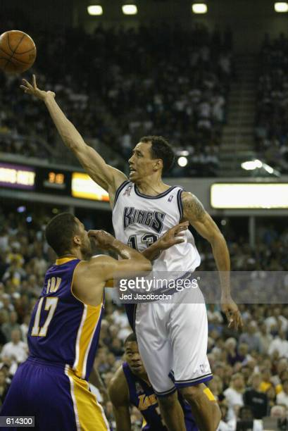 Doug Christie of the Sacramento Kings puts up a shot over Rick Fox of the Los Angeles Lakers in Game two of the Western Conference Finals during the...