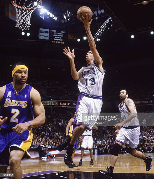 Doug Christie of the Sacramento Kings shoots the ball, during game 7 of the Western Conference Finals during the 2002 NBA Playoffs against the Los...