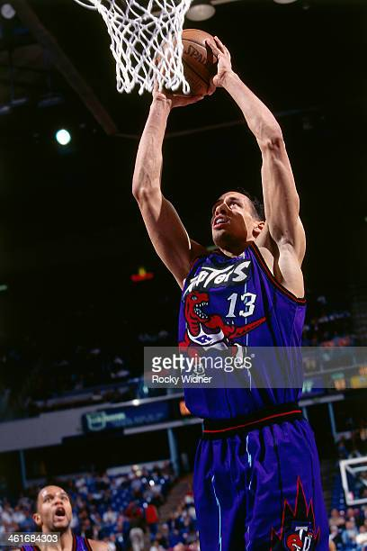 Doug Christie of the Toronto Raptors dunks during a game played on March 3 1997 at Arco Arena in Sacramento California NOTE TO USER User expressly...