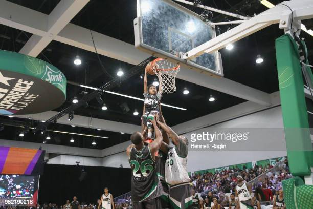 Doug Christine and The Game help Miles Brown dunk at the Celebrity Basketball Game Sponsored By Sprite during the 2018 BET Experience at Los Angeles...