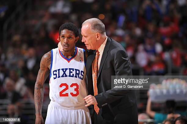 Doug Collins Head Coach of the Philadelphia 76ers gives direction to Louis Williams during the game against the Boston Celtics on March 7 2012 at the...