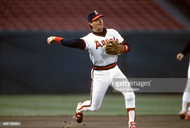 Doug DeCinces of the California Angeles looks to make a throw to first base during an Major League Baseball game circa 1986 at Anaheim Stadium in...
