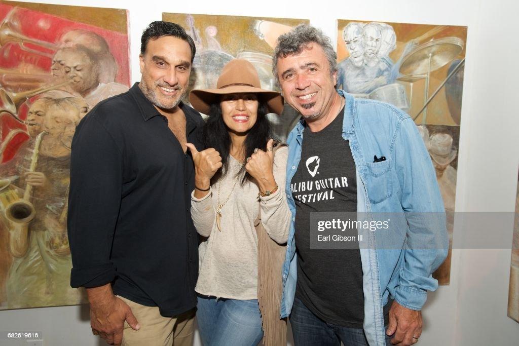 Doug DeLuca, Alejandra DeLuca and John Watkin attend the Malibu Guitar Festival Gallery Opening Reception at Malibu Village on May 12, 2017 in Malibu, California.