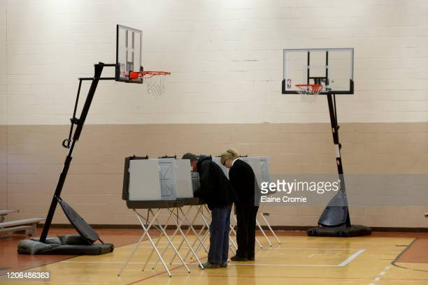 Doug Dicicco left, and his wife, Ruth Dicicco cast their votes at Warren Baptist Church on March 10, 2020 in Warren, Michigan. Michigan is one of six...
