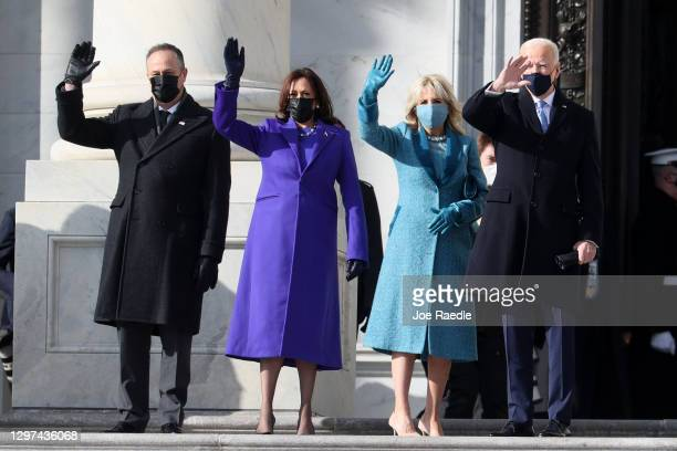 Doug Emhoff, U.S. Vice President-elect Kamala Harris, Jill Biden and President-elect Joe Biden wave as they arrive on the East Front of the U.S....