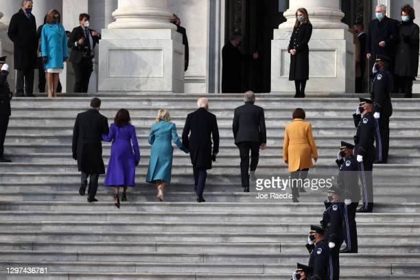 Doug Emhoff, U.S. Vice President-elect Kamala Harris, Jill Biden, President-elect Joe Biden, U.S. Sen. Roy Blunt and U.S. Sen. Amy Klobuchar walk...