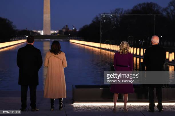 Doug Emhoff, Vice President-elect Kamala Harris, Dr. Jill Biden and President-elect Joe Biden face the Reflecting Pool as they observe a moment of...
