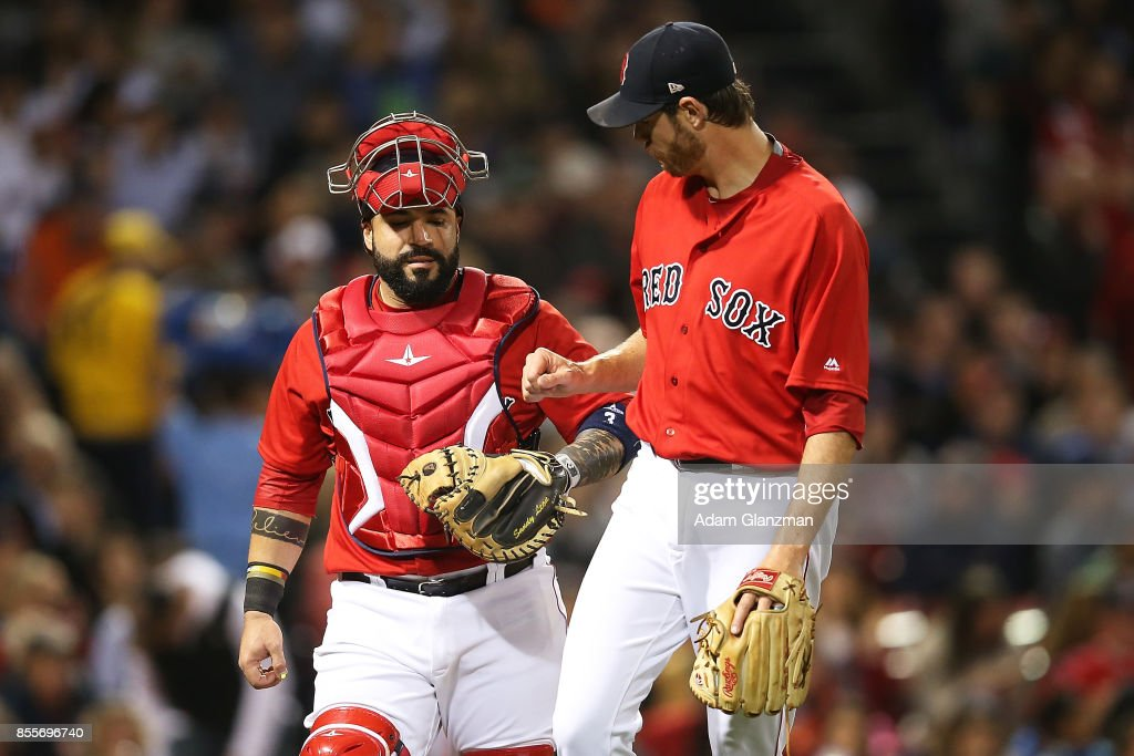 Doug Fister #38 high-fives Sandy Leon #3 of the Boston Red Sox in the third inning of a game against the Houston Astros at Fenway Park on September 29, 2017 in Boston, Massachusetts.