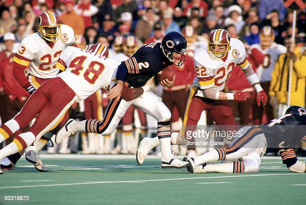 Doug Flutie of the Chicago Bears scrambles against Ken Coffey of the Washington Redskins during the 1986 NFC Divisional Playoff game at Soldier Field...