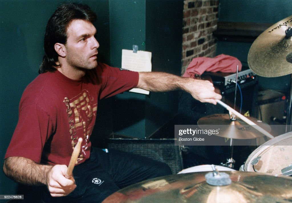 Doug Flutie plays the drums with his band, 'Catch This,' at the Great Scott in Brighton, Mass., March 31, 1993.