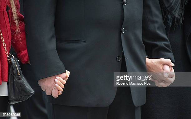 DOWNTOWN TORONTO ONTARIO CANADA Doug Ford hands holding Krita's and Karla's during Rob Ford funeral The procession walked from the City Hall to the...