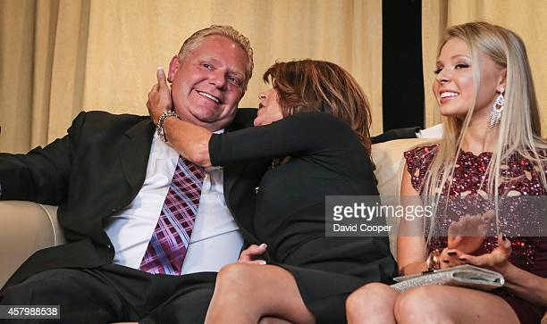 TORONTO ON OCTOBER 27 Doug Ford puts on a brave face after John Tory had been declared the winner as he get a kiss from his wife Karla in the...
