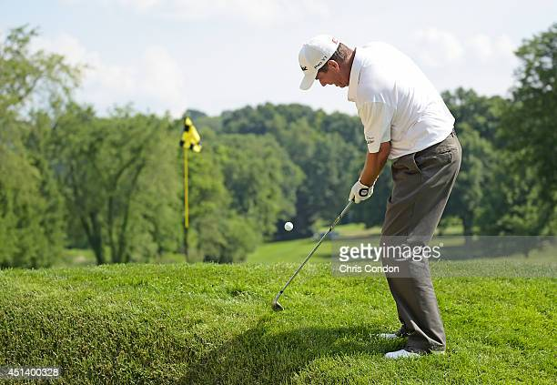 Doug Garwood chips backhanded to the 14th green during the third round of the Constellation SENIOR PLAYERS Championship at Fox Chapel Golf Club on...