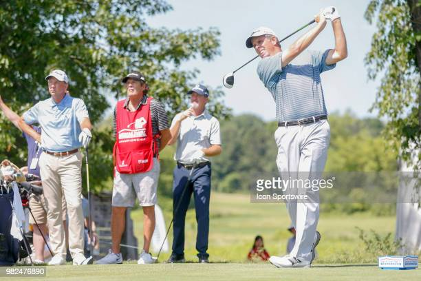 Doug Garwood tees off on the second tee while Jerry Kelly and Jerry Smith look on during the American Family Insurance Championship Champions Tour...
