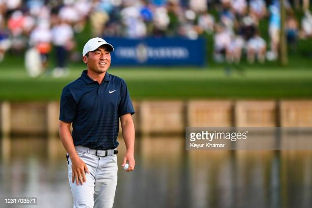 Doug Ghim smiles on the 17th hole green during the third round of THE PLAYERS Championship on the Stadium Course at TPC Sawgrass on March 13 in Ponte...