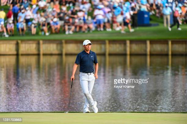 Doug Ghim stands and waits on the 17th hole green during the third round of THE PLAYERS Championship on the Stadium Course at TPC Sawgrass on March...